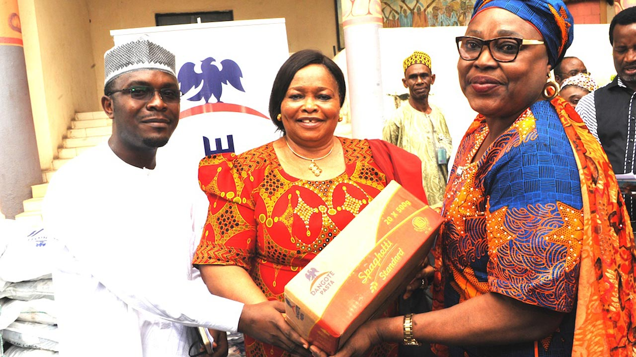 Director, Health and Nutrition, Dangote Foundation, Dr. Azeez Oseni (left) representative of Old Peoples Home, Abuja Dr. M. Ifeyinwa Obegolu and representative of the Minister of Federal Capital Territory, Mrs. Elegbede Irene Adebole,  during the donation of food items to the needy in Abuja.