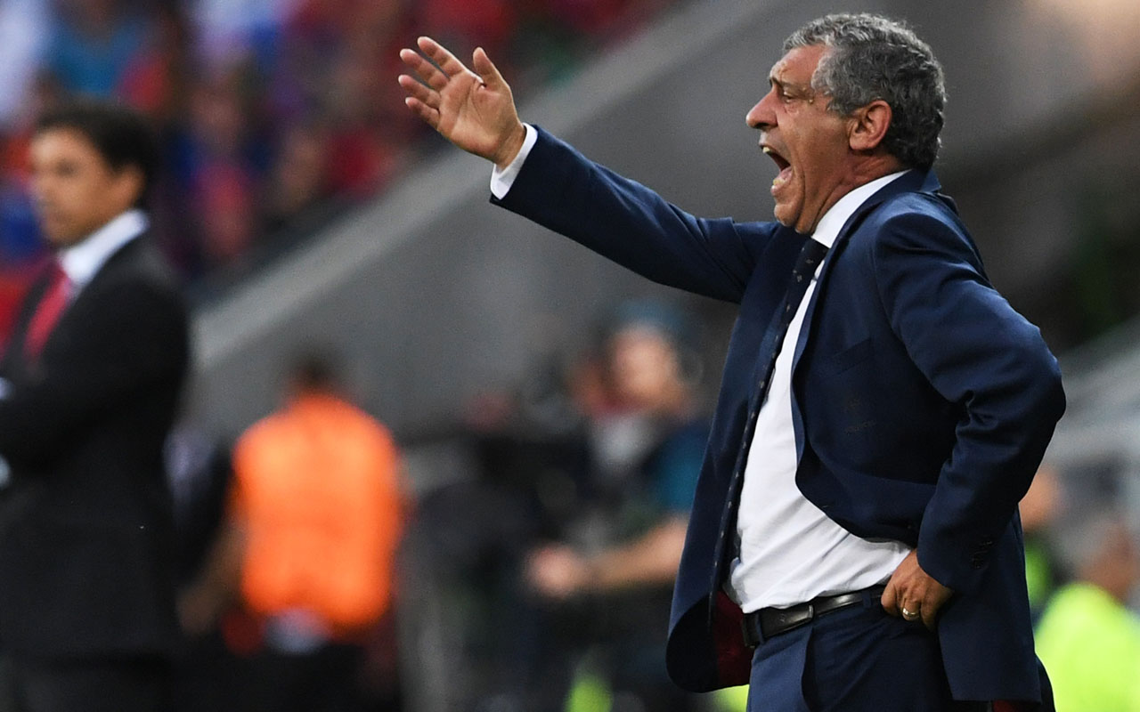Portugal's coach Fernando Santos gestures during the Euro 2016 semi-final football match between Portugal and Wales at the Parc Olympique Lyonnais stadium in Décines-Charpieu, near Lyon, on July 6, 2016.  / AFP PHOTO / Francisco LEONG