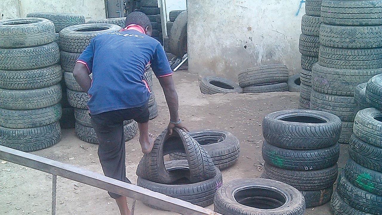 Handling or manhandling...A tyre 'specialist' at work