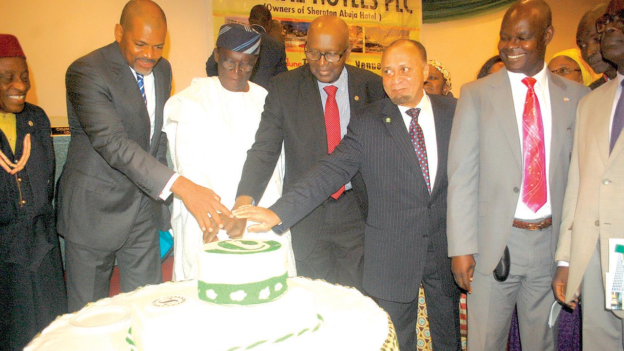 Management, board members and shareholders of Capital Hotels Plc cutting the cake at the AGM meeting in Abuja.