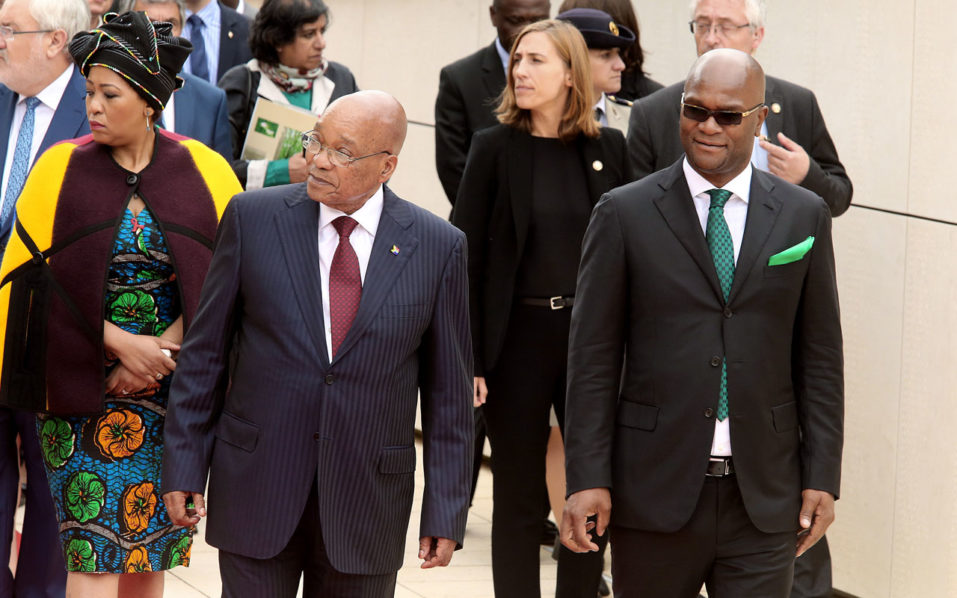 South African President Jacob Zuma (L) walks along a wall bearing names of South African troop who died during World War I at the memorial of Delville Wood during a ceremomy to commemorate the centenary of the Battle of Delville Wood in northern France on July 12, 2016 in Longueval.  The Battle of the Somme was launched on July 1 as Allied forces hoped to relieve the pressure on the French, who were racking up losses in Verdun by attacking the Germans further north at the Somme. However carnage ensued on both sides despite the frontline barely moving, in a battle that came to symbolise the horrors of trench warfare and the futility of the war.    / AFP PHOTO / FRANCOIS NASCIMBENI