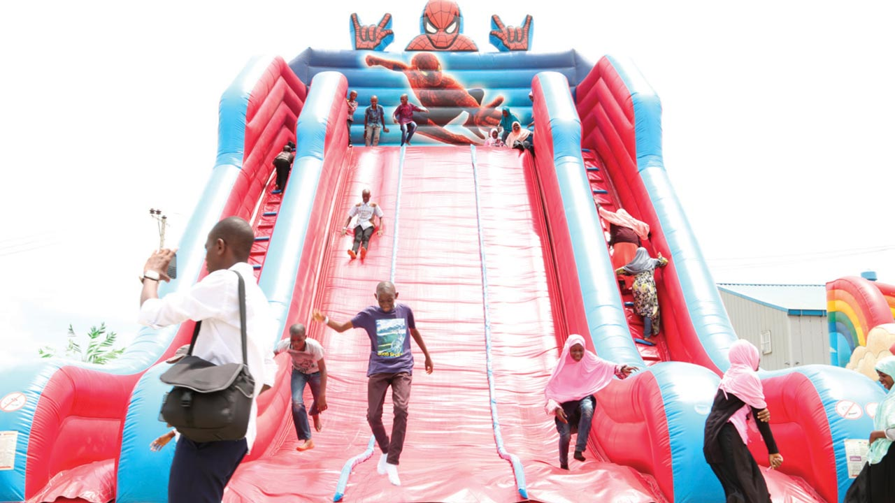 Children having fun at the Hi-Impact Planet amusement park, Lagos.