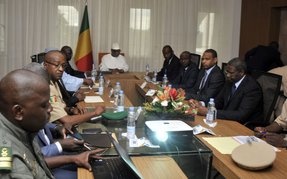 Malian President Ibrahim Boubacar Keita (C) attends a security meeting with the prime minister, defence minister and the commanders of the armed forceson July 19, 2016 at the presidential palace in Bamako, after the military camp in Nampala was attacked. At least 12 soldiers were killed in central Mali on July 19 in an attack on their base claimed by gunmen from the Peul ethnic group. The gunmen's descent on the military camp in Nampala was earlier claimed by a group calling themselves the National Alliance for the Protection of Peul Identity and Restoration of Justice (ANSIPRJ). / AFP PHOTO / HABIBOU KOUYATE