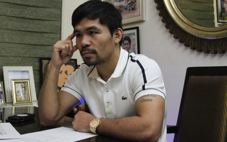 In this picture taken on July 13, 2016, Philippine boxing icon Manny Pacquiao gestures during a media interview at his residence in General Santos City, on the southern island of Mindanao. Pacquiao has declared he still has the passion for the sport and may come out of retirement, although there are no plans for a fight this year. / AFP PHOTO / Aquiles ZONIO