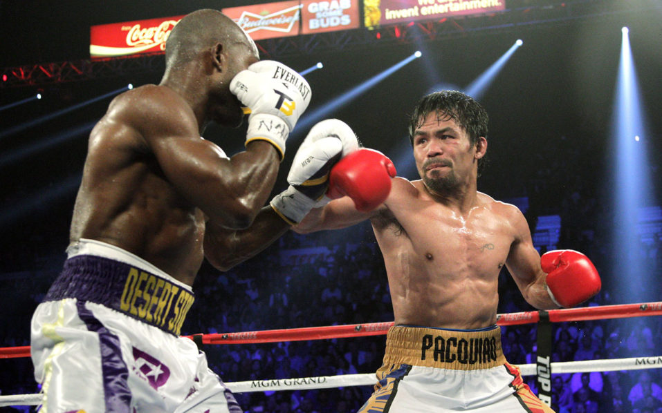 (FILES) This file photo taken on April 9, 2016 shows Manny Pacquiao (R) and Timothy Bradley Jr. facing off during their WBO international welterweight title bout at the MGM Grand Arena in Las Vegas, Nevada.  Filipino boxing star Manny Pacquiao plans to come out of retirement to fight an as yet to be named opponent later this year, ESPN reported on July 12, 2016. / AFP PHOTO / John GURZINSKI