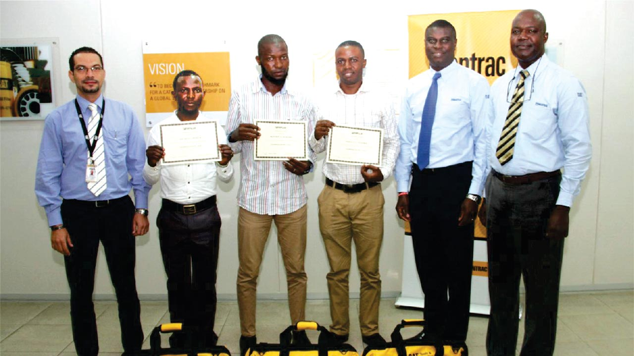 Mantrac Nigeria, Service Operations Manager, Ahmed Ragab; recipients, Abiakun Samuel, Olorunlama Adebowale and Shodeinde Seun; Mantrac Nigeria, Managing Director, Edmund Martin-Lawson; and Technical Training Manager, Lateef Adenle, at the presentation of certificates and Cat kits to three of the successful candidates of Cat on-line technicians for Africa, by Mantrac Nigeria, recently.
