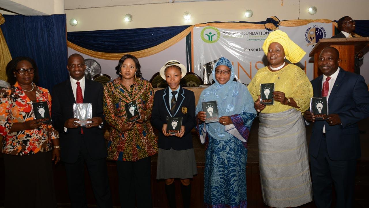 Mrs. Olawunmi Togonu Bickersteth (left); Mr. Oladele Alabi; Mrs. Amira Obi-Okoye; the student author, Miss Maryam Popoola; her mother, Mrs. Maryam Popoola; Mrs. Ronke Soyombo and author's father, Mr. Tunde Popoola at the unveiling of the book in Lagos.