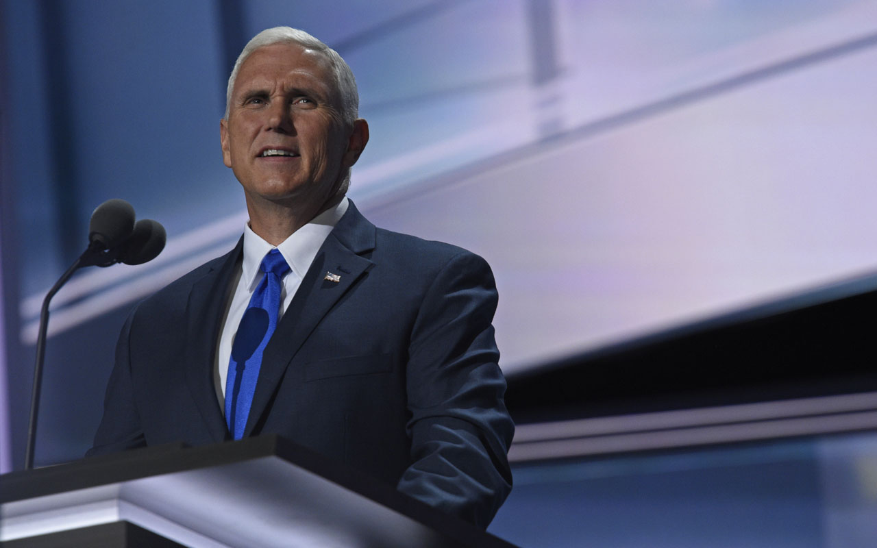 Vice presidential candidate Mike Pence acknowledges the audience at the end of the third day of the Republican National Convention at the Quicken Loans Arena in Cleveland, Ohio on July 20, 2016. / AFP PHOTO / DOMINICK REUTER
