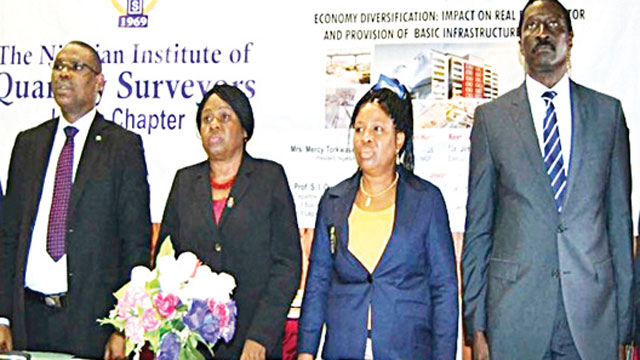 Executive Secretary/CEO Financial Reporting Council of Nigeria), Mr. Jim Osayande Obazee, President, Nigerian Institute of Quantity Surveyors, Mrs. Mercy Torkwase Iyortyer; NIQS Lagos Chapter Chairman, Mrs. Adenike Ayanda and President/Founder, First World Communities Limited, Gen P. M. Tunde Reis (rtd) at 8th Annual Distinguished Lecture of NIQS Lagos Chapter.