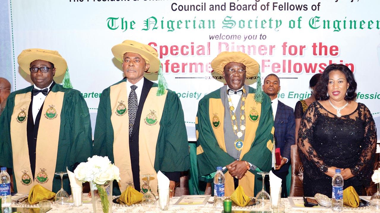 Deputy President of Nigerian Society of Engineers(NSE), Mr. Adekunle Mokuolu (left); Chairman, NSE Board of Fellows, Mr. Chris Okoye; NSE President, Mr. Otis Anyaeji and wife, Nkeji at the Special Dinner/Conferment of Fellowship of NSE held in Abuja, recently