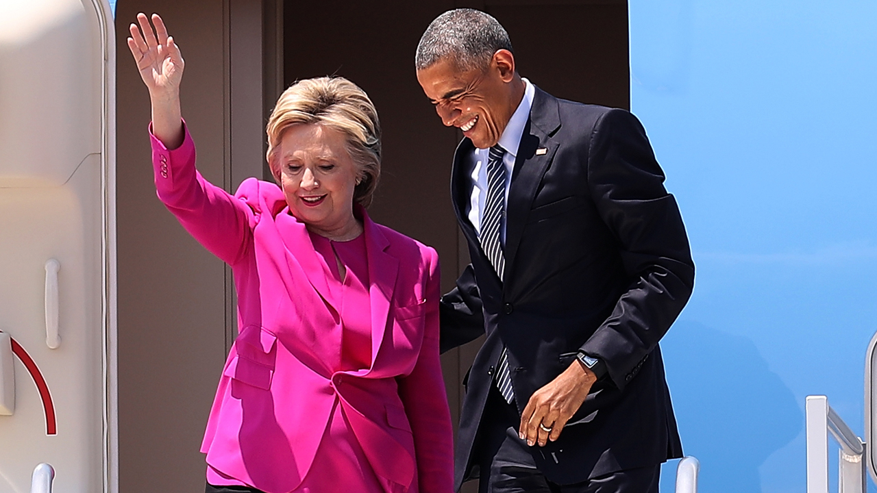 Democratic presidential candidate former Secretary of State Hillary Clinton (L) walks off of Air Force One with U.S. president Barack Obama on July 5, 2016 in Charlotte, North Carolina. Hillary Clinton is campaigning with president Obama in North Carolina. Justin Sullivan/Getty Images/AFP