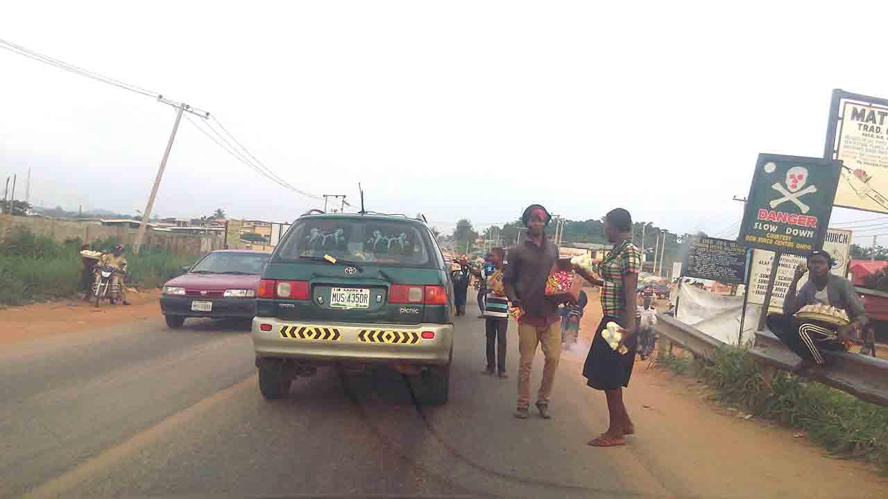 Hawkers displaying thier wares on the road in Akure, Ondo State capital                          PHOTO: OLUWASEUN AKINGBOYE