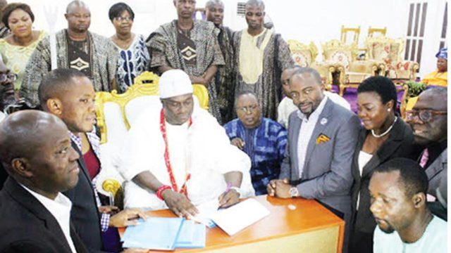 Ooni of Ife, Oba Adeyeye Enitan Ogunwusi (middle) signing the MoU for the project with guests and palace officials