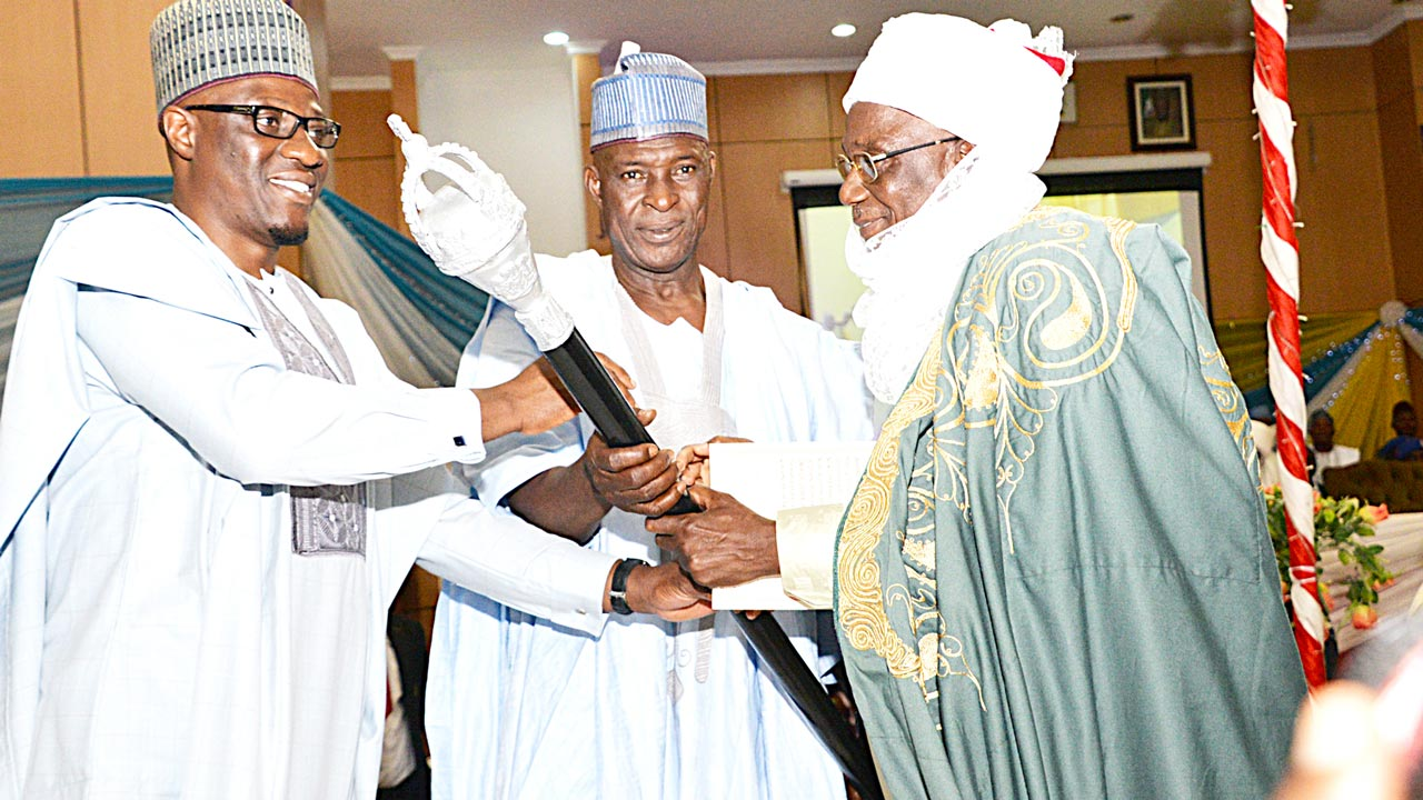Kwara State Governor, Dr. Abdulfatah Ahmed (left); Commissioner for Local Government and Chieftaincy Affairs, Alhaji Haruna Tambiri; and Emir of Ilesha Baruba, Prof. Halidu Abubakar, during the presentation of 1st Class Staff of Office to the Emir at State Banquet Hall, Ilorin…yesterday.