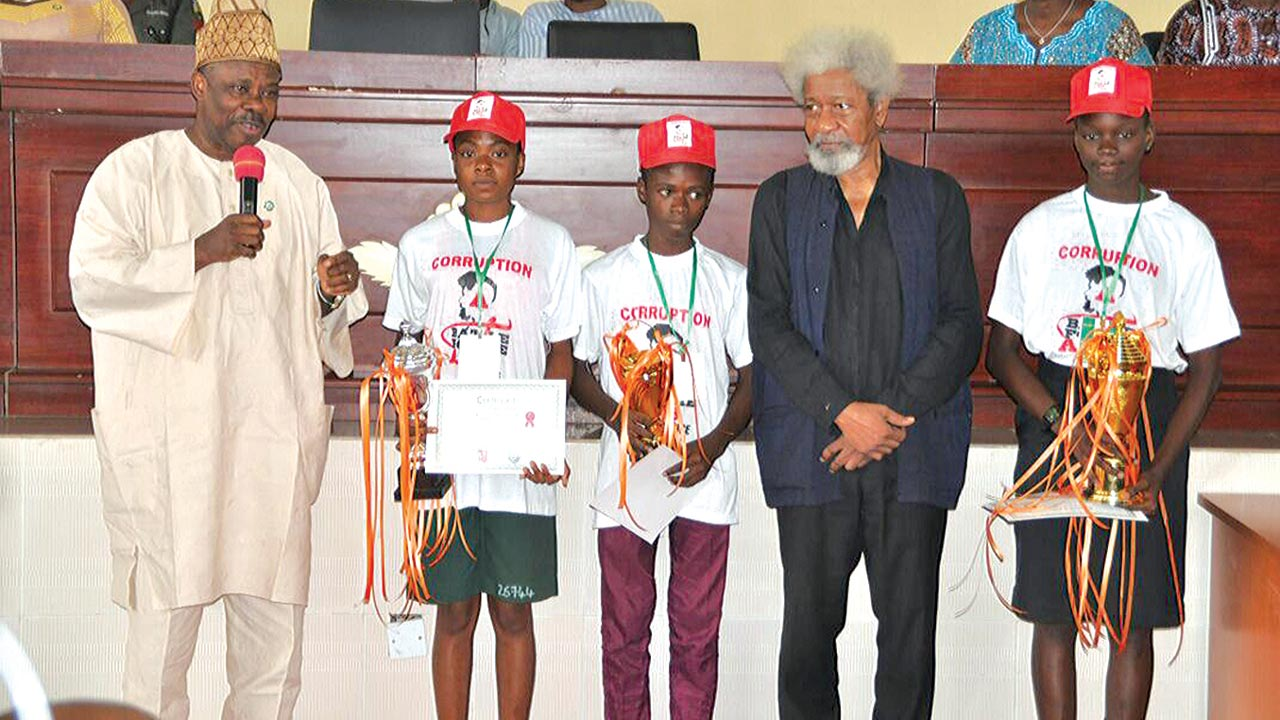 Miss. Naomi Akinremi of St. Peter's College, Olomore, Abeokuta (first position, right); Nobel Laureate, Prof. Wole Soyinka; Friday Zacheaus of Adeola Odutola College, Ijebu-Ode (third position); Miss. Adedoyin Sotonwa of May Flower Secondary School, Ikenne (second position); and Ogun State Governor, Senator Ibikunle Amosun at the Grand Finale of the Wole Soyinka International Cultural Exchange programme held at the Obas Complex, Oke-Mosan, Abeokuta...yesterday