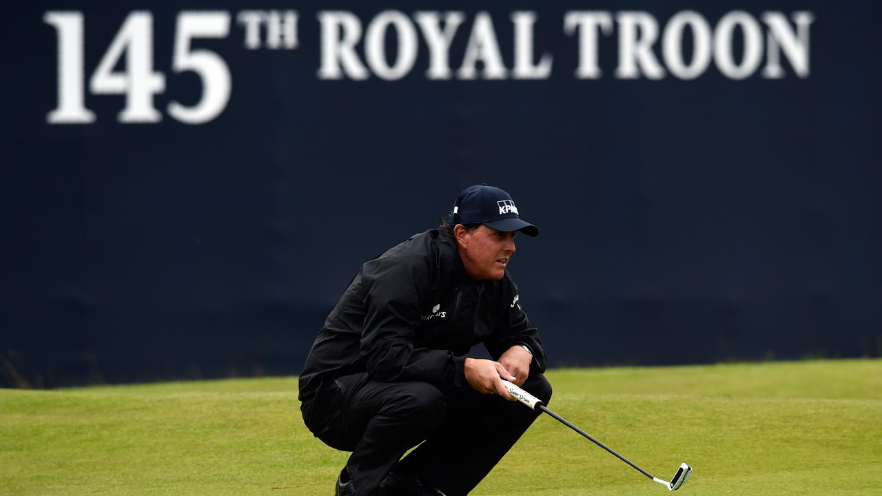 US golfer Phil Mickelson lines up a putt on the 18th green during his second round 69 on day two of the 2016 British Open Golf Championship at Royal Troon in Scotland on July 15, 2016. Phil Mickelson held his lead at the British Open on Friday after a second-round 69 left him at 10 under par heading into the weekend. ANDY BUCHANAN / AFP