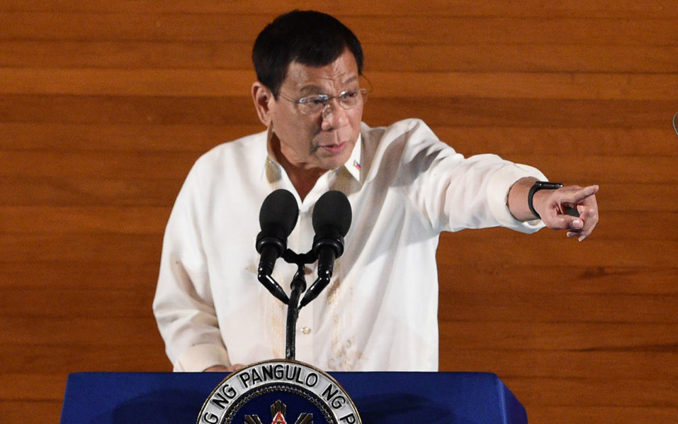 Philippine President Rodrigo Duterte gestures as he delivers his State of the Nation Address at Congress in Manila on July 25, 2016. Duterte announced a unilateral ceasefire with communist rebels who are waging one of Asia's longest insurgencies, and urged them to reciprocate. / AFP PHOTO / TED ALJIBE