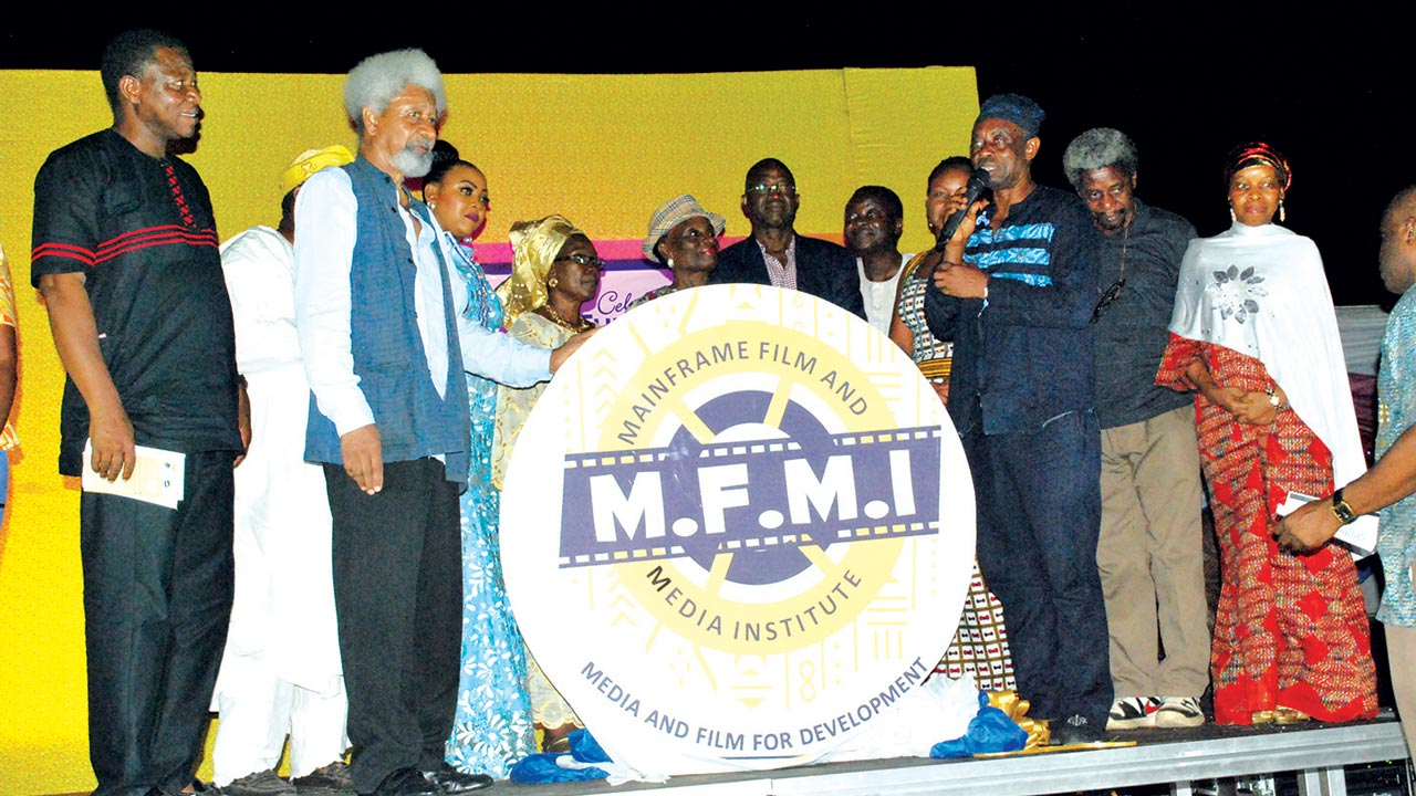 Professor Wole Soyinka (left), Kelani (right) and others at the unveiling of the logo of the film school
