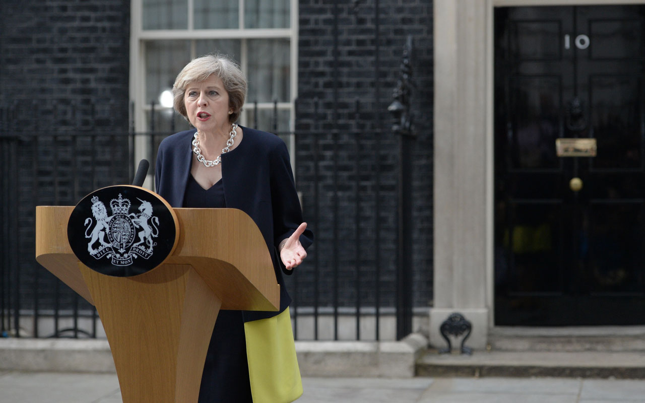 Britain's new Prime Minister Theresa May speaks outside 10 Downing Street in central London on July 13, 2016 on the day she takes office following the formal resignation of David Cameron. Theresa May took office as Britain's second female prime minister on July 13 charged with guiding the UK out of the European Union after a deeply devisive referendum campaign ended with Britain voting to leave and David Cameron resigning. / AFP PHOTO / OLI SCARFF