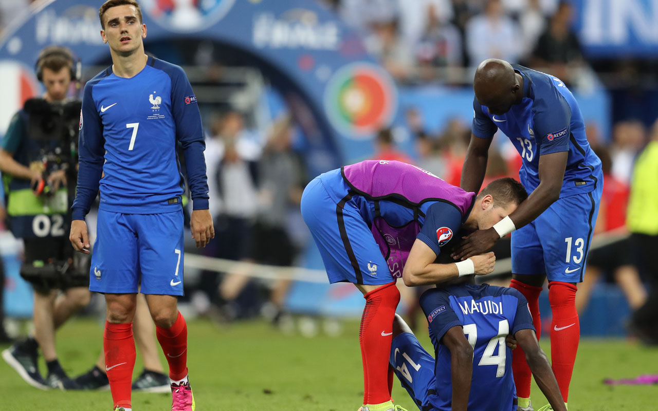 ... midfielder Blaise Matuidi (2nd R) and France's defender Eliaquim  Mangala (R) react after they lost the Euro 2016 final football match  against Portugal ...