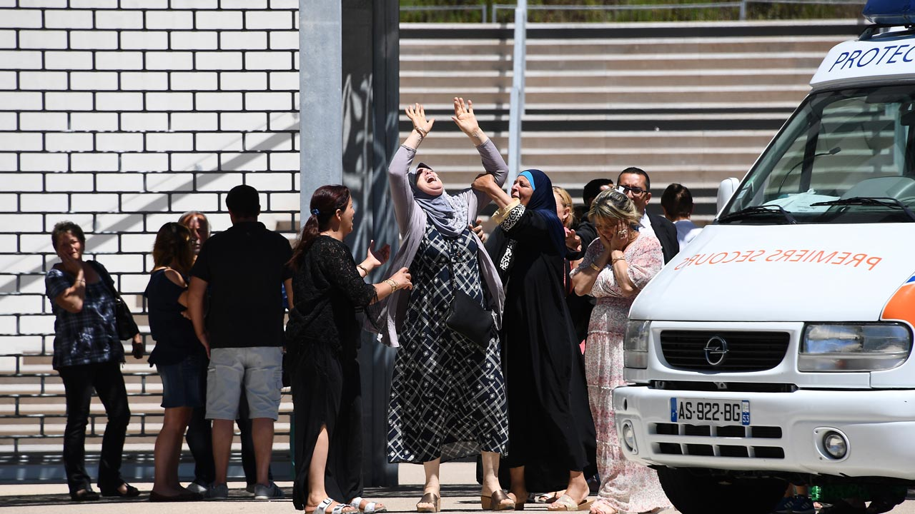A woman reacts after she found out the death of her grandson as she still searches for her daughter at the Pasteur hospital in Nice on July 16, 2016. The Islamic State group claimed responsibility for the truck attack that killed 84 people in Nice on France's national holiday, a news service affiliated with the jihadists said Saturday. Tunisian Mohamed Lahouaiej-Bouhlel, 31, smashed a 19-tonne truck into a packed crowd of people in the Riviera city celebrating Bastille Day -- France's national day. ANNE-CHRISTINE POUJOULAT / AFP