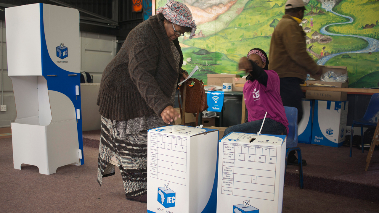A woman casts her ballot at a polling station in Imizamo Yethu, an impoverished informal settlement in Hout Bay, during South African municipal elections, on August 3, 2016, in Cape Town. South Africans voted Wednesday in closely contested municipal elections that could deal a heavy blow to the African National Congress (ANC), which has ruled since leading the struggle to end apartheid. Nelson Mandela's former party risks losing control of key cities including the capital Pretoria, the economic hub Johannesburg and coastal Port Elizabeth, according to some polls. RODGER BOSCH / AFP