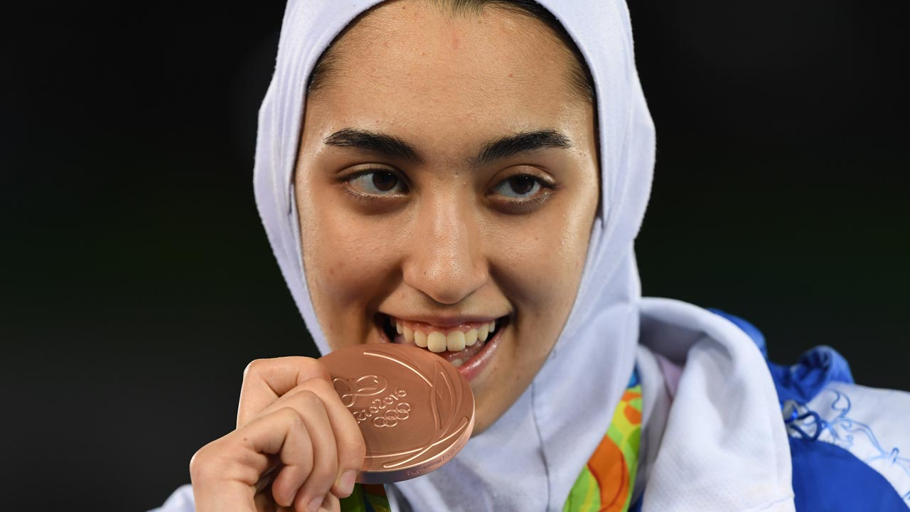 Iran's Kimia Alizadeh Zenoorin poses with her bronze medal on the podium after the women's taekwondo event in the -57kg category as part of the Rio 2016 Olympic Games, on August 18, 2016, at the Carioca Arena 3, in Rio de Janeiro. Kirill KUDRYAVTSEV / AFP