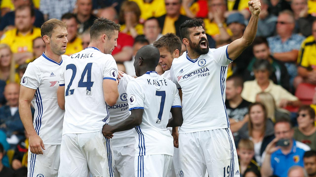Chelsea's Brazilian-born Spanish striker Diego Costa (R) celebrates scoring their second goal during the English Premier League football match between Watford and Chelsea at Vicarage Road Stadium in Watford, north of London on August 20, 2016. Ian Kington / AFP