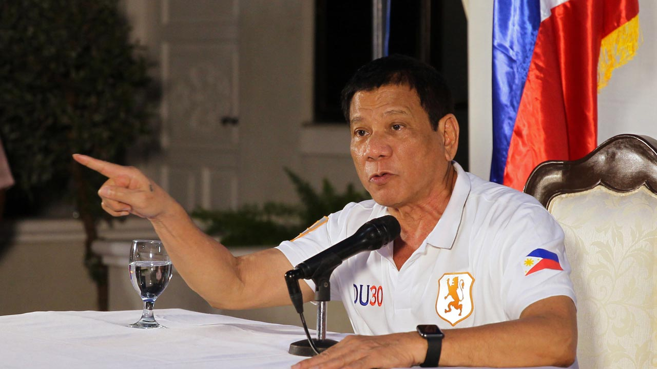 This handout photo taken on August 21, 2016 and released by the Presidential Photographers Dividion (PPD) shows President Rodrigo R. Duterte gesturing as he speaks during a press conference at the presidential guest house in Davao City. Duterte on August 21 threatened to pull the Philippines out of the United Nations as he ratcheted up his war of words with the global organisation over this bloody war on crime. KARL ALONZO / PPD / AFP