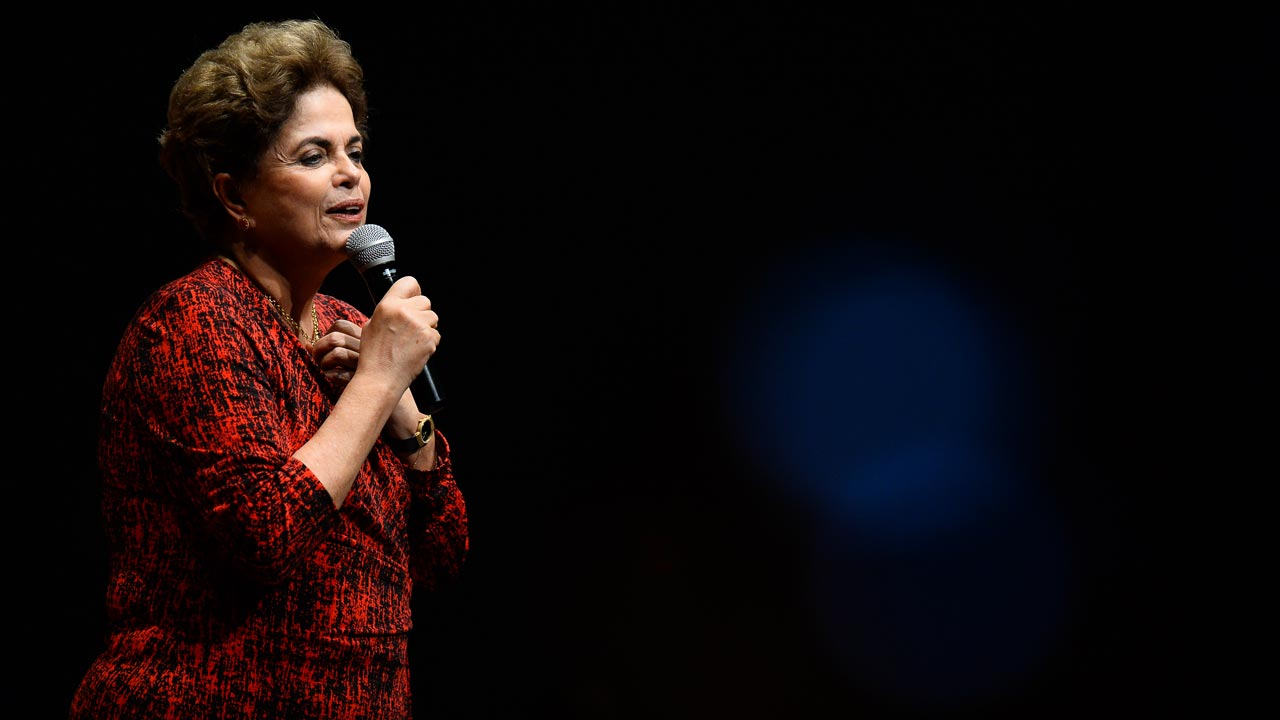 Brazilian suspended President Dilma Rousseff speaks during a Workers' Party rally in Brasilia on August 24, 2016. Brazil's suspended president Dilma Rousseff enters her final battle to win back power on Thursday, when senators open an impeachment trial expected to remove her from office for good. ANDRESSA ANHOLETE / AFP