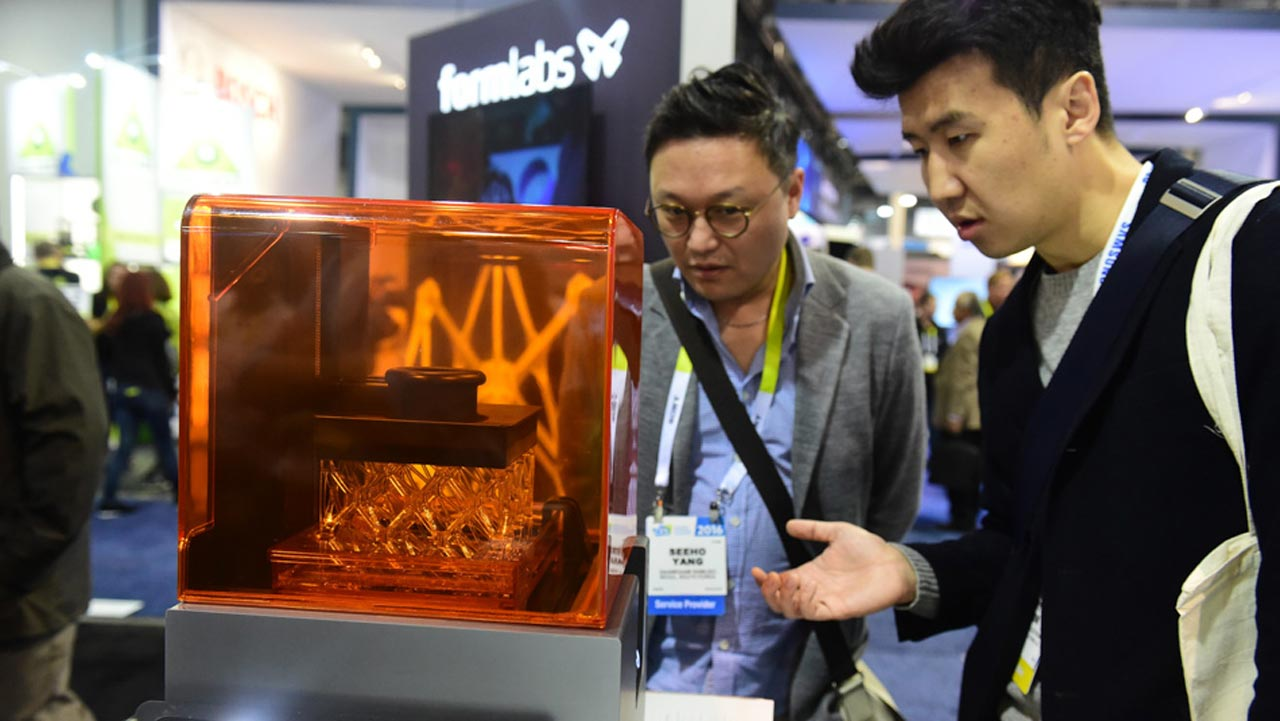 People look at the Form 3D desktop printer by Formlabs during the 2016 Consumer Electronics Show (CES), an annual trade show focusing on consumer technology, in Las Vegas, Nevada, Thursday. The Form 2 is a professional desktop printer that sells for USD 3,499. PHOTO BY ROBYN BECK, AFP PHOTO