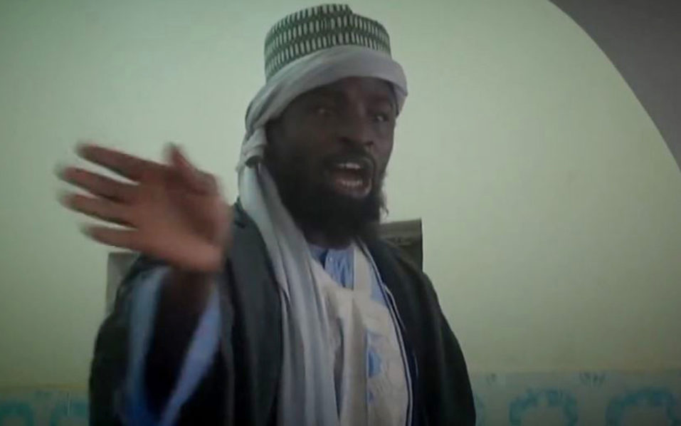 "(FILES) This file screengrab taken on November 9, 2014 from a Boko Haram video released by the Nigerian Islamist extremist group Boko Haram and obtained by AFP shows the leader of the Nigerian Islamist extremist group Boko Haram, Abubakar Shekau preaching to locals in an unidentified town. Boko Haram's elusive leader Abubakar Shekau said in an audio message on August 4, 2016 he is around despite his reported ouster as leader of the Nigeria-based jihadist group by the Islamic State (IS).""People should know we are still around,"" Shekau said in a 10-minute audio message. / AFP PHOTO / BOKO HARAM / HO"
