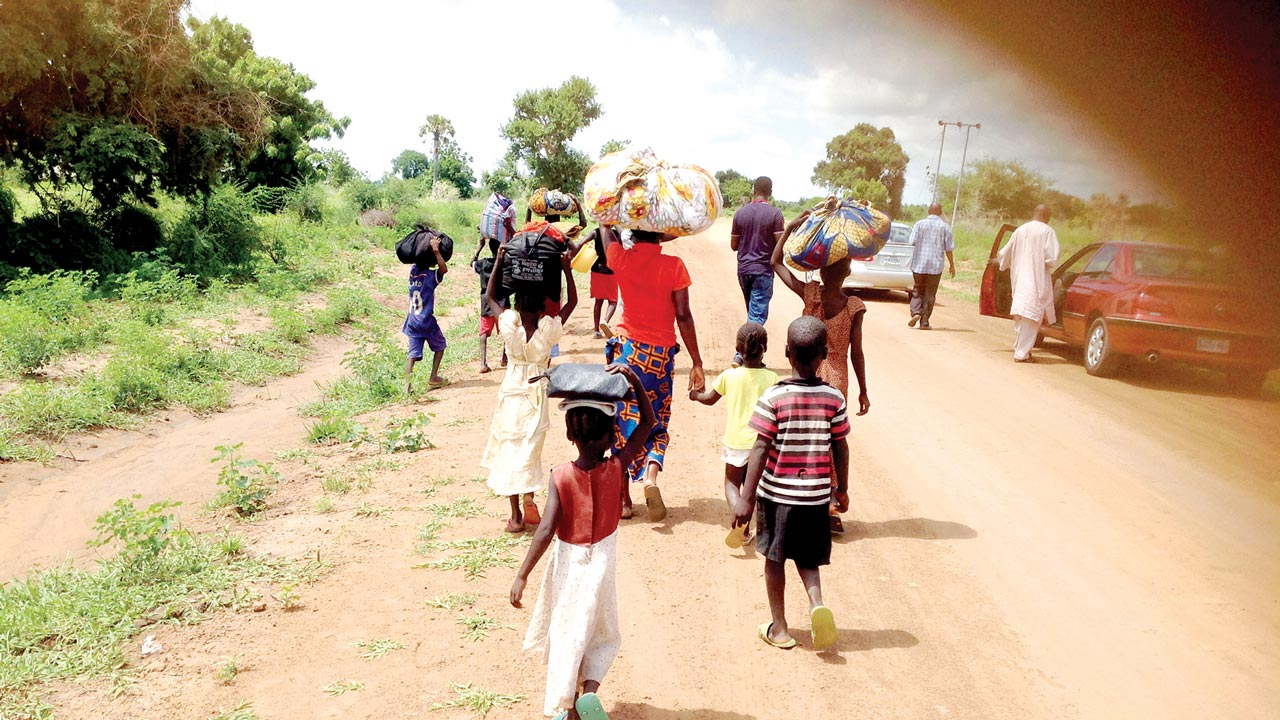 Displaced persons moving out of affected communities PHOTO: Emmanuel Ande