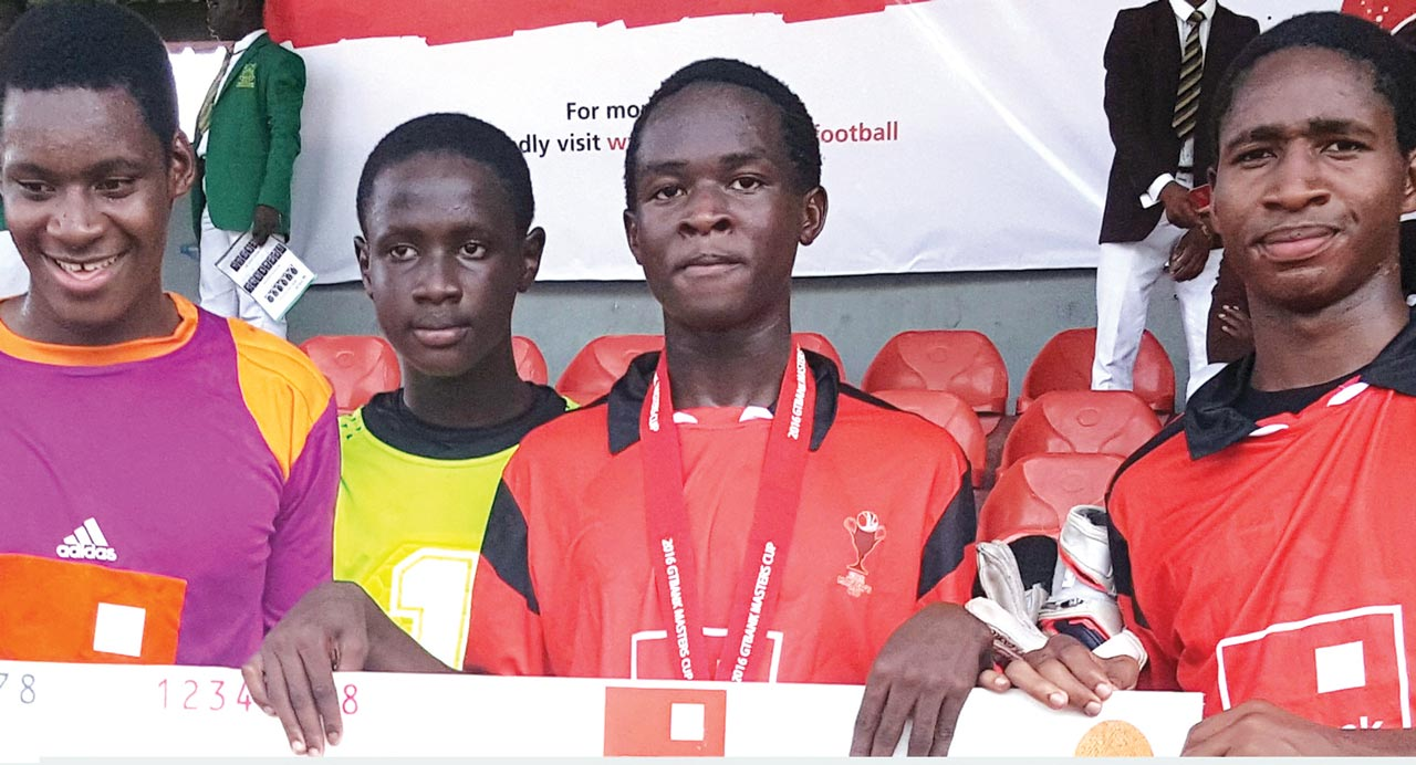 The champion…Adeola with the trophy after leading Greensprings school, Lekki, to win the annual GTbank sports competition in Lagos.