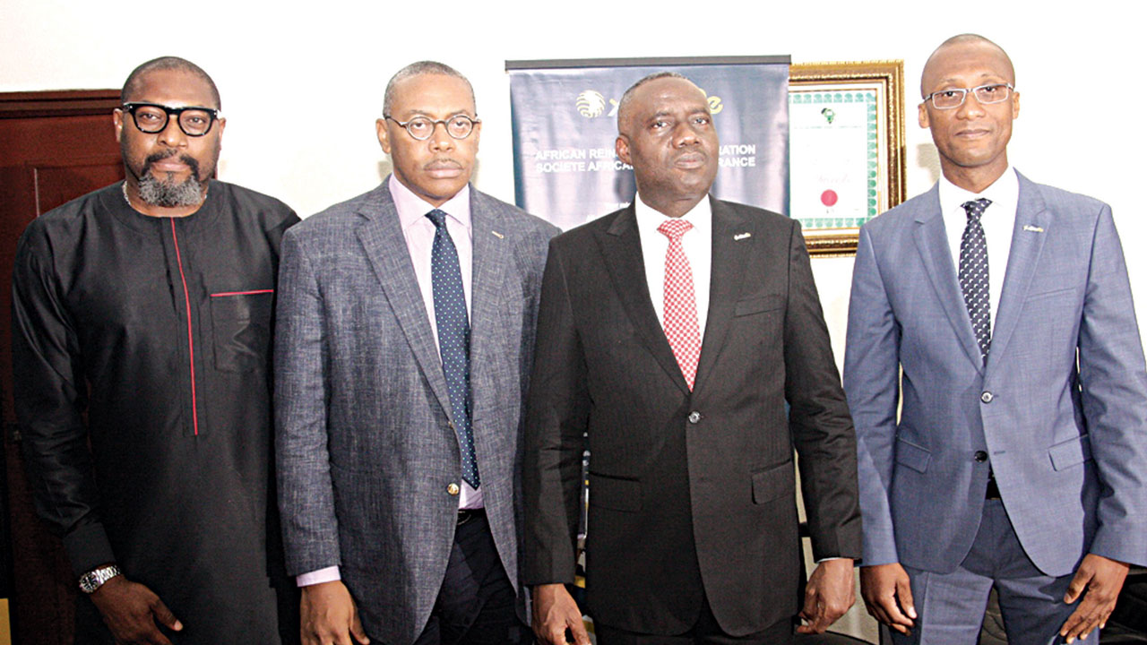 Project Brand Consultant, Charles O'Tudor (left); Managing Director, DDB, Ikechi Odigbo; Deputy Managing Director/Chief Operating Officer, Africa Reinsurance, Ken Aghoghovbia; and Regional Director, West Africa, Africa Reinsurance, Sory Diomande, during Africa Re's Insurance awareness campaign, in Lagos.