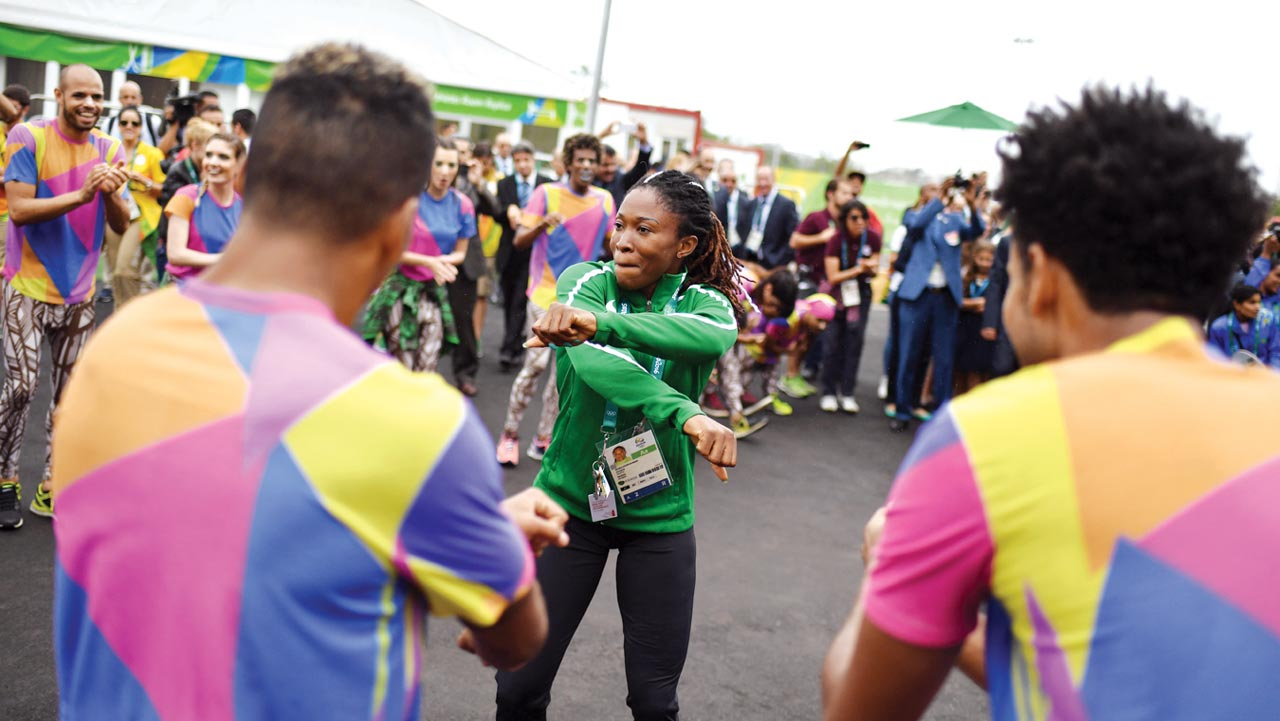 Sprinter, Amaka Ogoegbunam, joins dancers performing for Team Nigeria at the Athletes' Village ahead of the Rio 2016 Olympic Games' opening ceremony.                       PHOTO: AFP.