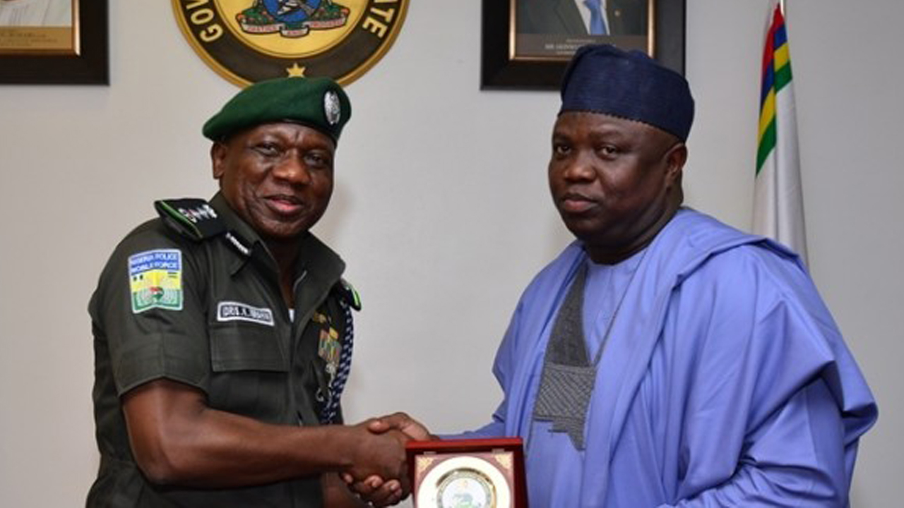 Acting Inspector-General of Police Idris Kpotun Ibrahim receiving a gift from Lagos State Governor, Akinwunmi Ambode at the Lagos House, Alausa, Ikeja, on Wednesday, August 3, 2016. PHOTO: LASG