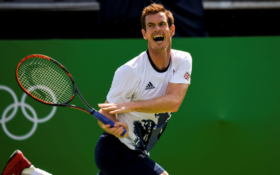 Great Britain's Andy Murray returns the ball during a training session at the Olympic Tennis Center in Rio de Janeiro on August 4, 2016, ahead of the Rio 2016 Olympic Games.  / AFP PHOTO / Martin BERNETTI