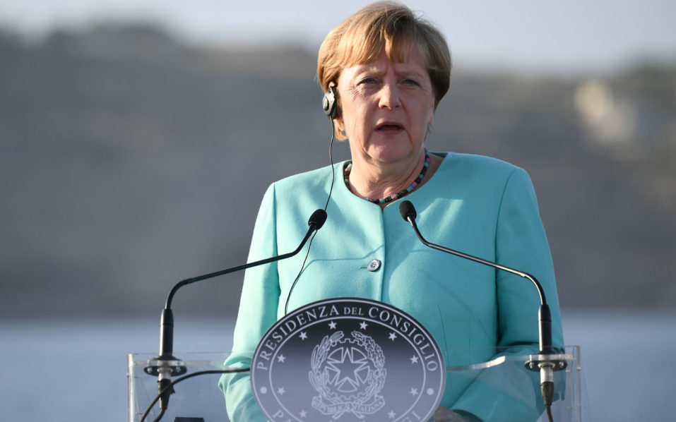 German Chancellor Angela Merkel delivers a speech on August 22, 2016 during a joint press conference with France's President and Italian Prime Minister held aboard of the Garibaldi navy on the harbour of Italian island of Ventotene, ahead of a meeting on the island, where the leaders of Italy, France and Germany meet to discuss the post-Brexit EU. Europe's economic outlook, jihadist attacks, the refugee and migrant drama, the Syrian conflict, and relations with Russia and Turkey were all on the agenda for the talks later Monday on the island of Ventotene, one of the cradles of the European dream. / AFP PHOTO / VINCENZO PINTO