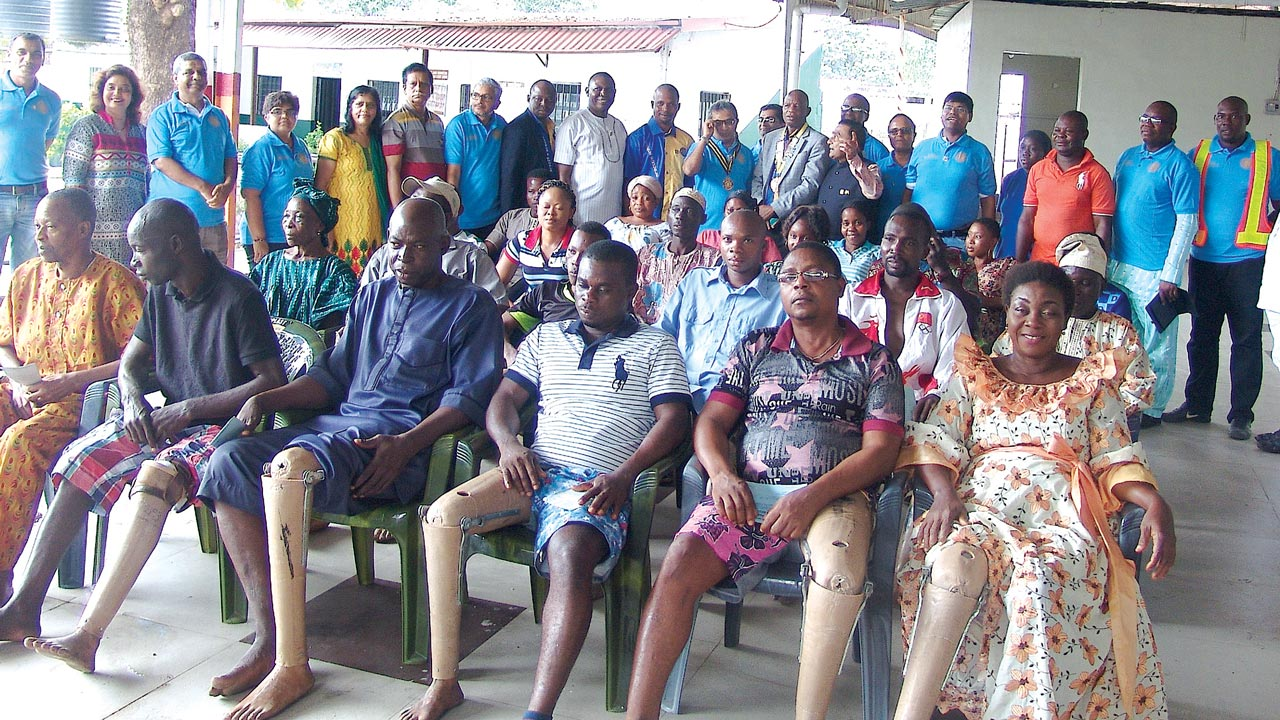 Receipients (seated) with Rotary officials (standing back) at the event.Governor,