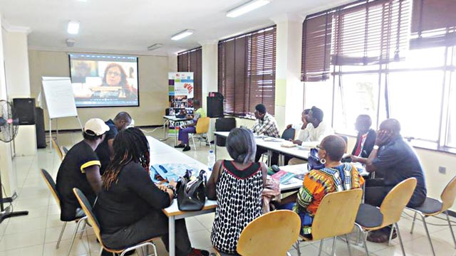 Participants at the Lagos edition of Arterial Project Management programme watching the video of a presentation.