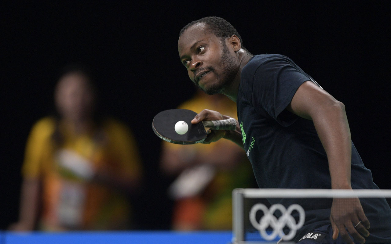 Nigeria's Aruna Quadri serves to a teammate during a table tennis training session at the Riocentro complex in Rio de Janeiro on August 4, 2016, ahead of the Rio 2016 Olympic Games. / AFP PHOTO / JUAN MABROMATA