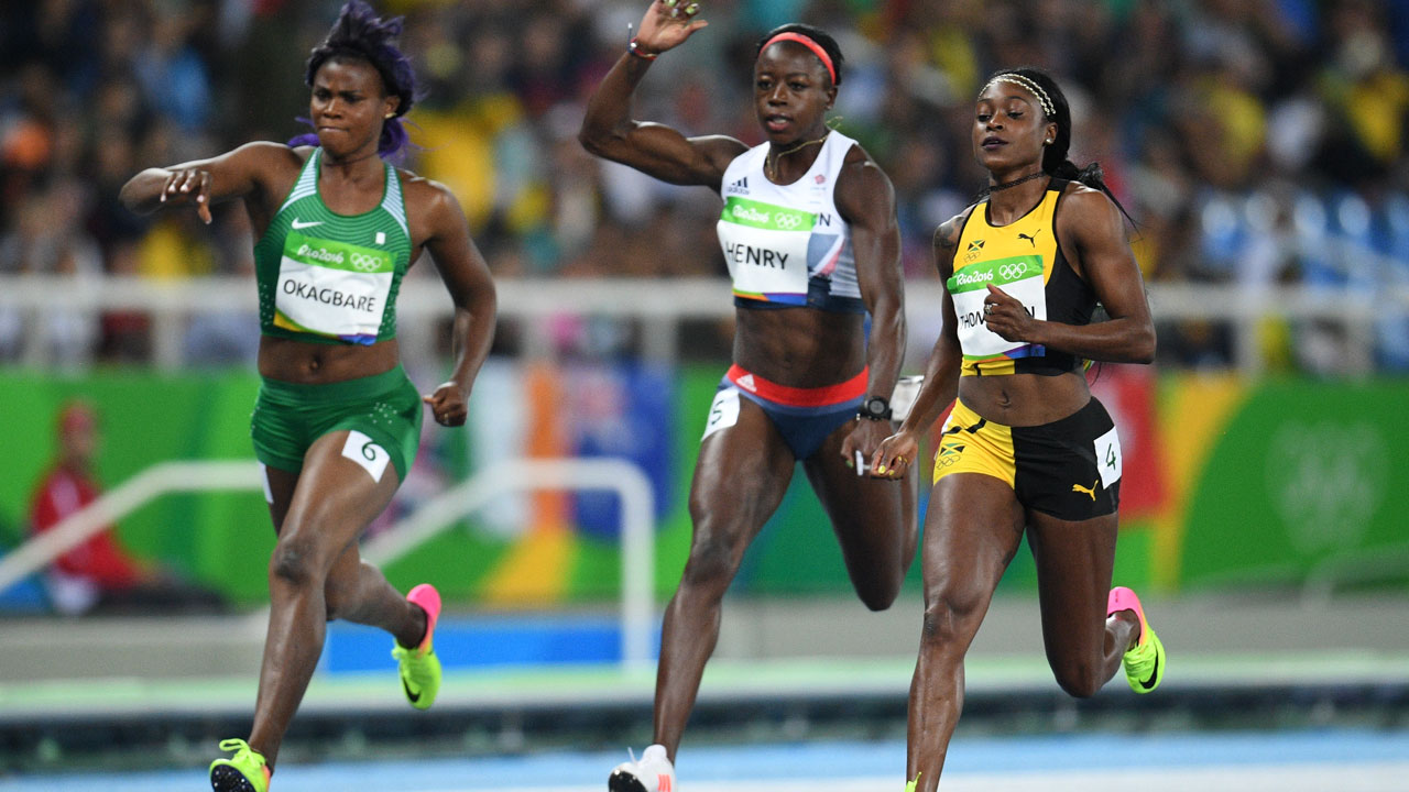 (L-R) Nigeria's Blessing Okagbare, Britain's Desiree Henry, and Jamaica's Elaine Thompson compete in the Women's 100m Semifinal during the athletics event at the Rio 2016 Olympic Games at the Olympic Stadium in Rio de Janeiro on August 13, 2016. Johannes EISELE / AFP