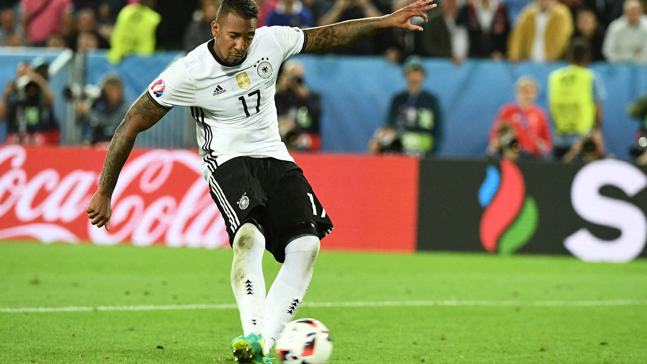 (FILES) This file photo taken on July 02, 2016 shows Germany's defender Jerome Boateng spot-kicking a goal during a penalty shoot-out in the Euro 2016 quarter-final football match between Germany and Italy at the Matmut Atlantique stadium in Bordeaux. Jerome Boateng's way into the world top was long and rocky. Now the central defender from Bayern Munich was voted Germany's Footballer of the Year. VINCENZO PINTO / AFP