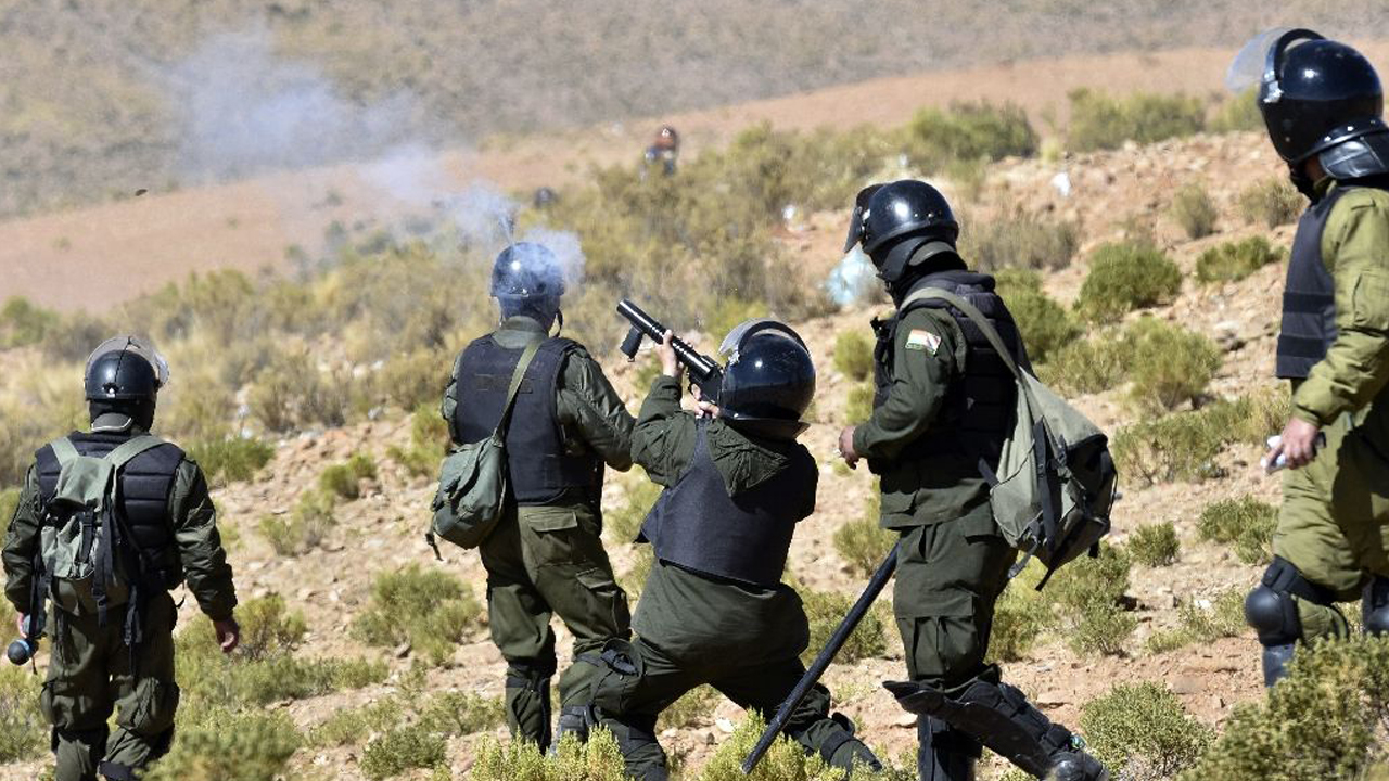 Riot police fire tear gas during clashes with miners in Panduro, La Paz department, Bolivia Riot police fire tear gas during clashes with miners in Panduro, La Paz department, Bolivia. PHOTO: AFP/Aizar Raldes