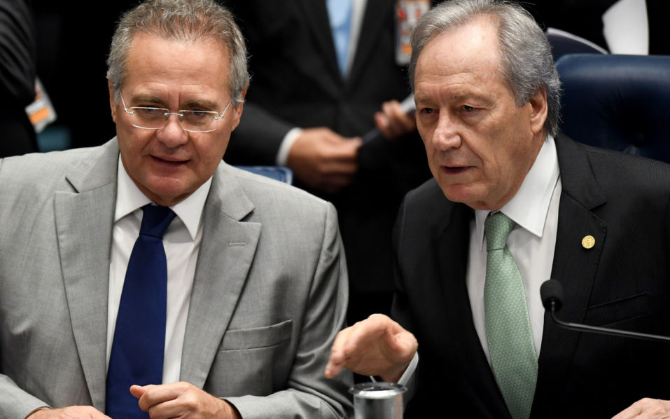 Brazilian Supreme Court's President Ricardo Levandowski (R) talks with Senate's President Renan Calheiros during the Senate impeachment trial of Brazilian President Dilma Rousseff at the National Congress in Brasilia on August 25, 2016. The impeachment trial of Brazil's first woman president, Dilma Rousseff, got underway Thursday with high expectations that the suspended leader of Latin America's biggest economy will be sacked within days. / AFP PHOTO / EVARISTO SA