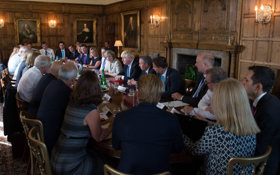"""Britain's Prime Minister Theresa May (4R) speaks as she chairs a cabinet meeting sat next to British Foreign Secretary Boris Johnson (3R) at the Prime Minister's country retreat Chequers near the village of Ellesborough in Buckinghamshire, northwest of London, on August 31, 2016.  The British prime minister chaired a meeting of the cabinet on August 31 to discuss Brexit and the next steps the government needs to take. Also on the agenda were the economy, social reform and the forthcoming legislative programme ahead of the return of parliament from the summer recess on September 5.  / AFP PHOTO / POOL / Stefan Rousseau / CORRECTION TO DATE  """"The erroneous mention[s] appearing in the metadata of this photo by Stefan Rousseau has been modified in AFP systems in the following manner: [Pictures were taken on August 31] instead of [August 30]. Please immediately remove the erroneous mention[s] from all your online services and delete it (them) from your servers. If you have been authorized by AFP to distribute it (them) to third parties, please ensure that the same actions are carried out by them. Failure to promptly comply with these instructions will entail liability on your part for any continued or post notification usage. Therefore we thank you very much for all your attention and prompt action. We are sorry for the inconvenience this notification may cause and remain at your disposal for any further information you may require."""""""