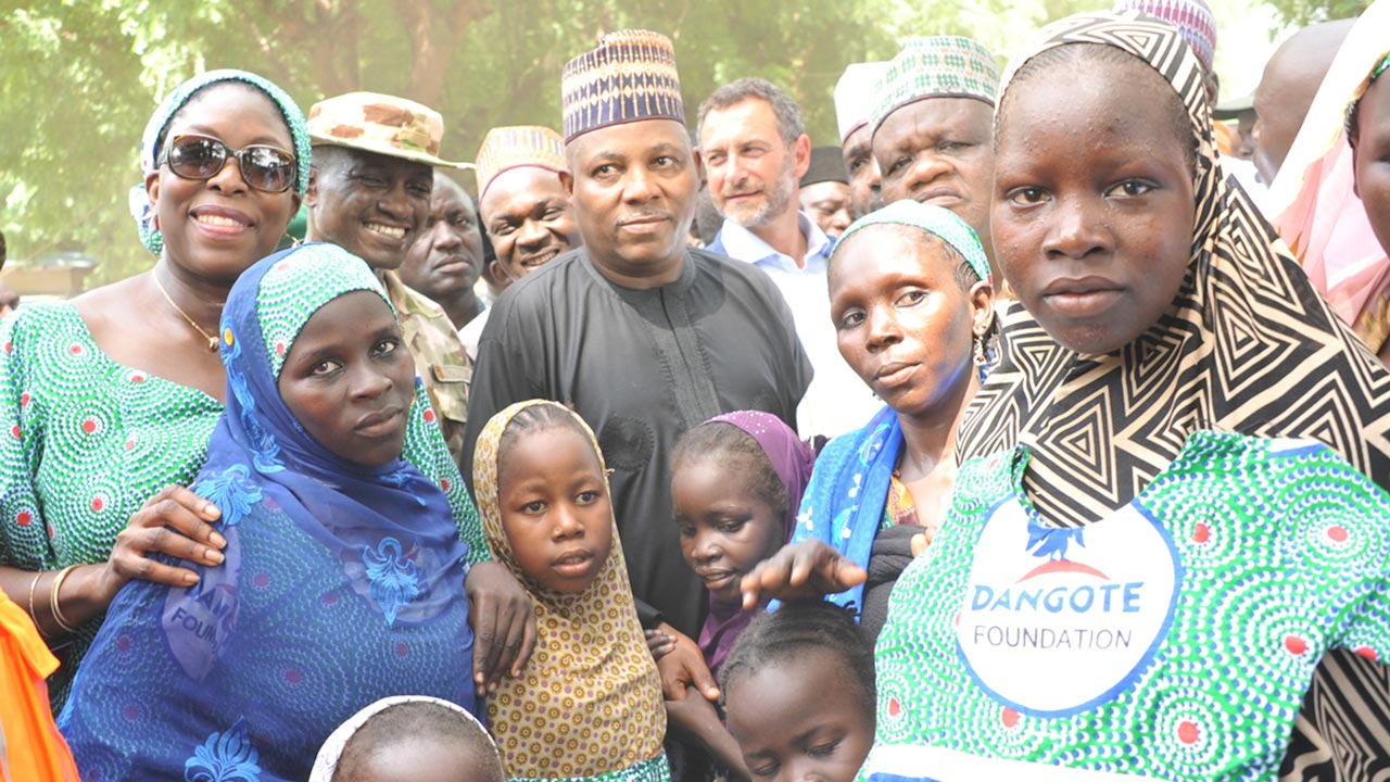 Managing Director/CEO, Dangote Foundation, Zouera Youssoufou (left); Borno State governor, Kashim Shettima (middle), and others, with beneficiaries of the clothing materials, blankets and shoes donated to IDPs in Bama, Borno, by the Dangote Foundation...yesterday