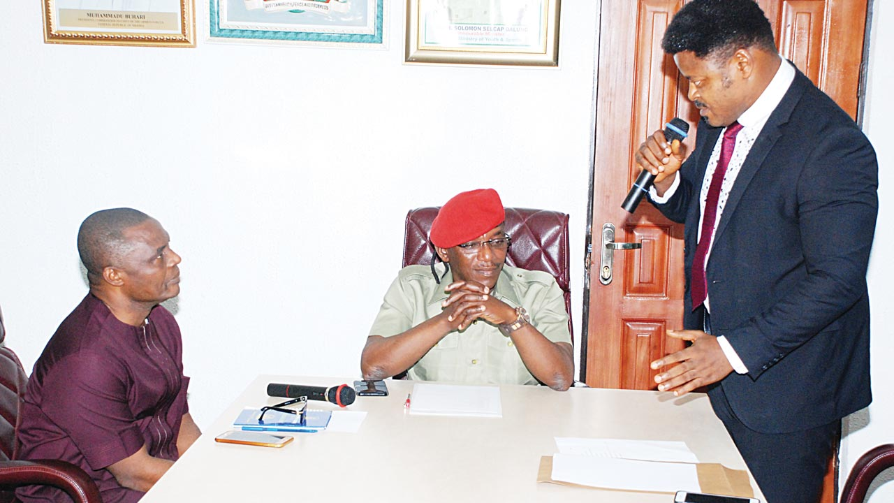Sports Minister, Solomon Dalung (middle) and Permanent Secretary, Chris Ohaa (left), listening to De Ultimate Commander when the wrestler led a delegation to the minister's office in Abuja…yesterday. PHOTO: KANAYO UMEH