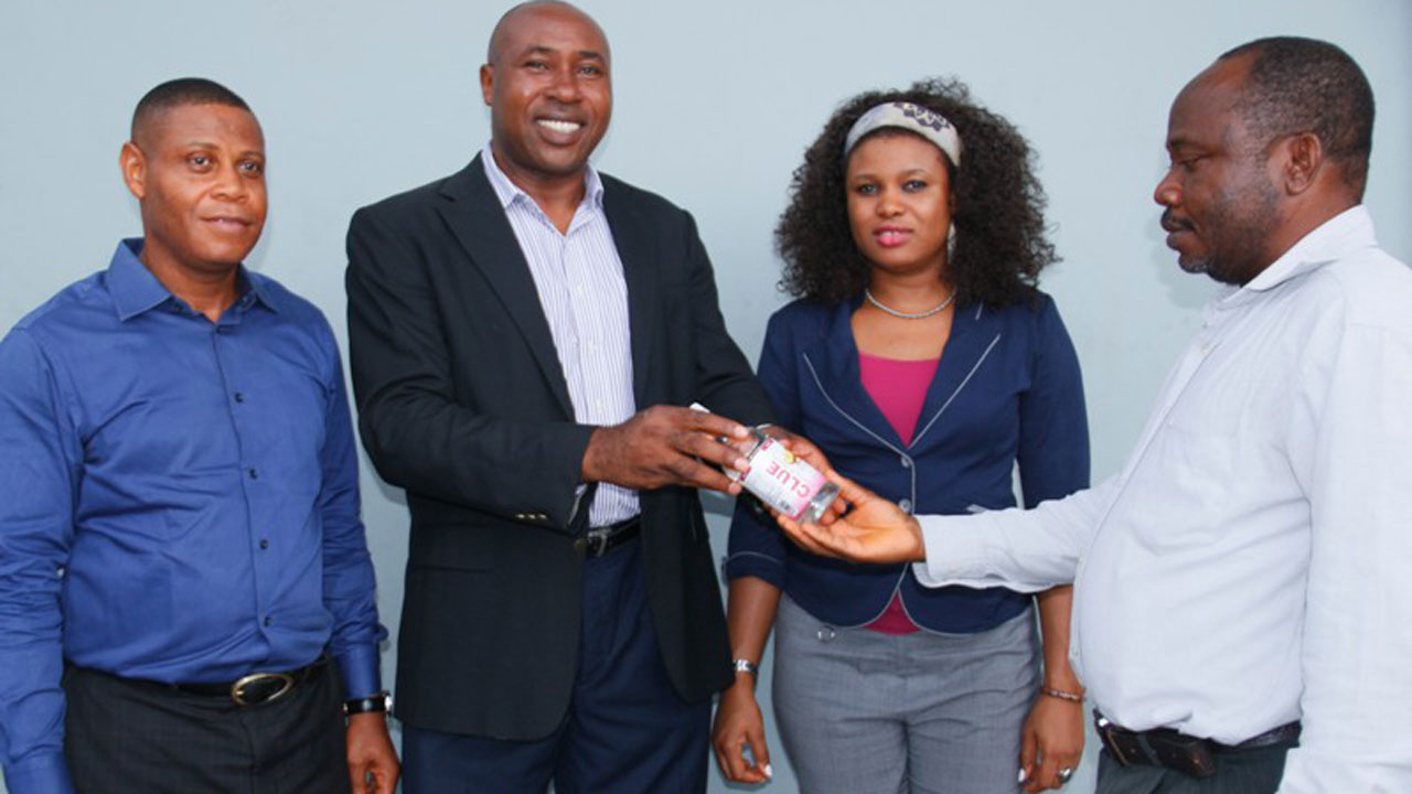 Managing Director/Chief Executive Officer, Denna Rossi Ltd, Dr Ifeanyi Nwafor (Second left); flanked by Head, Marketing/Corporate Services, Ifeanyi Nihe (left); and Manager, Human Resource, Ms Frances Ogbeche, during the presentation of Clue Vitamin Beverage to a customer as part of activities to launch the product.